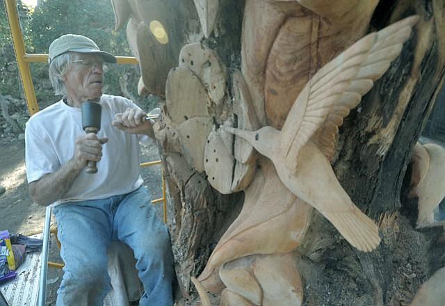 """Larry Lefner works on """"Humingbird Heaven""""."""