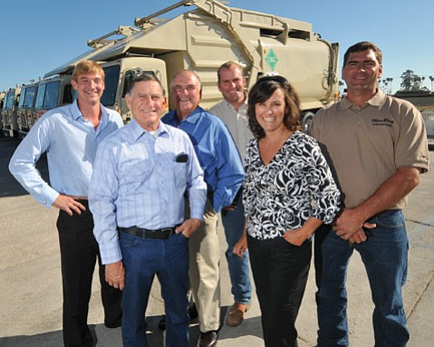 By a commitment to recycling and political savvy, Mario Borgatello (second from left) has emerged as the major player in South Coast trash disposal.