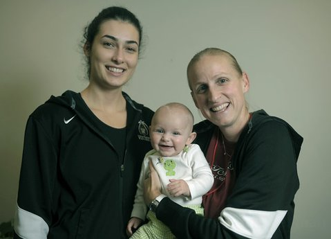 Westmonts Tue Canitez (left) with womens basketball coach Kirsten Moore and Moores daughter, Alexis.