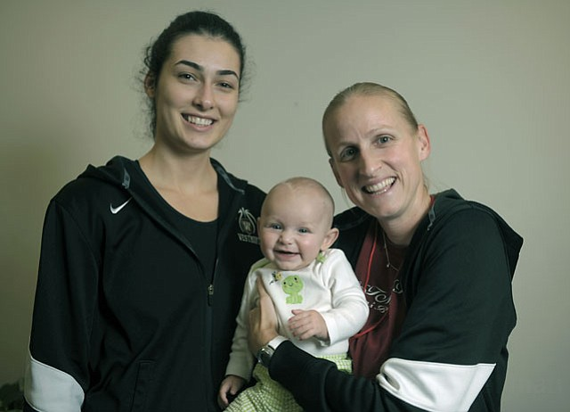 Westmont's Tuğçe Canitez (left) with women's basketball coach Kirsten Moore and Moore's daughter, Alexis.