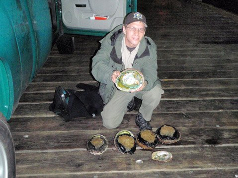 Scott Cohen, with confiscated red abalone.