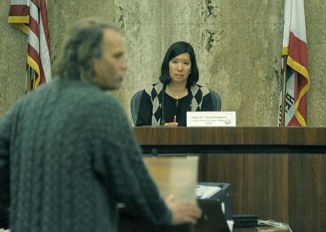 Judge Amy Yip-Kikugawa listens to testimony from Bryan Rosen about smart meters (Dec. 14, 2012)