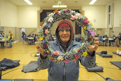 Murari Avery displays a wreath she made by hand from found objects. Though she didn't stay at the warming center at First United Methodist Church the evening this photo was taken, she stopped by to gift the wreath to shelter director Maria Long.