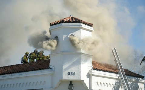 Firefighters are currently aggressively attacking the flames and smoke at the former home of Montecito Motors.