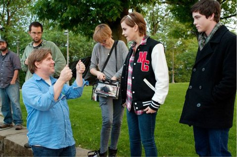(From left to right) Director Stephen Chbosky speaks with Emma Watson and Logan Lerman on the set of <em>The Perks of Being a Wallflower</em>.