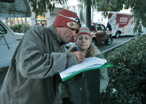 Jerry filled out paperwork for surveyor Lisa Bidlow during the 2011 homeless count.
