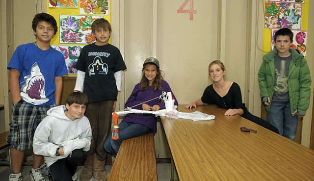 Washington School GATE students posed after winning the Engineering Challenge at the Math Fair on December 18, 2012.