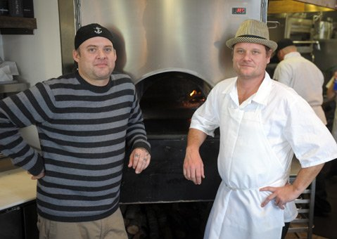 <b>FIRE, FIRE!</b> Anchor Woodfire Kitchen's executive chef and owner, Jason Tuley (left), with his chef de cuisine, Charlie Fredericks.