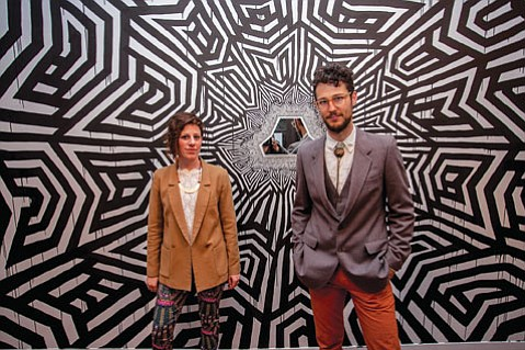 "Hannah Rose Vainstein and Nathan Hayden in front of their collaboration ""our powers combined."""