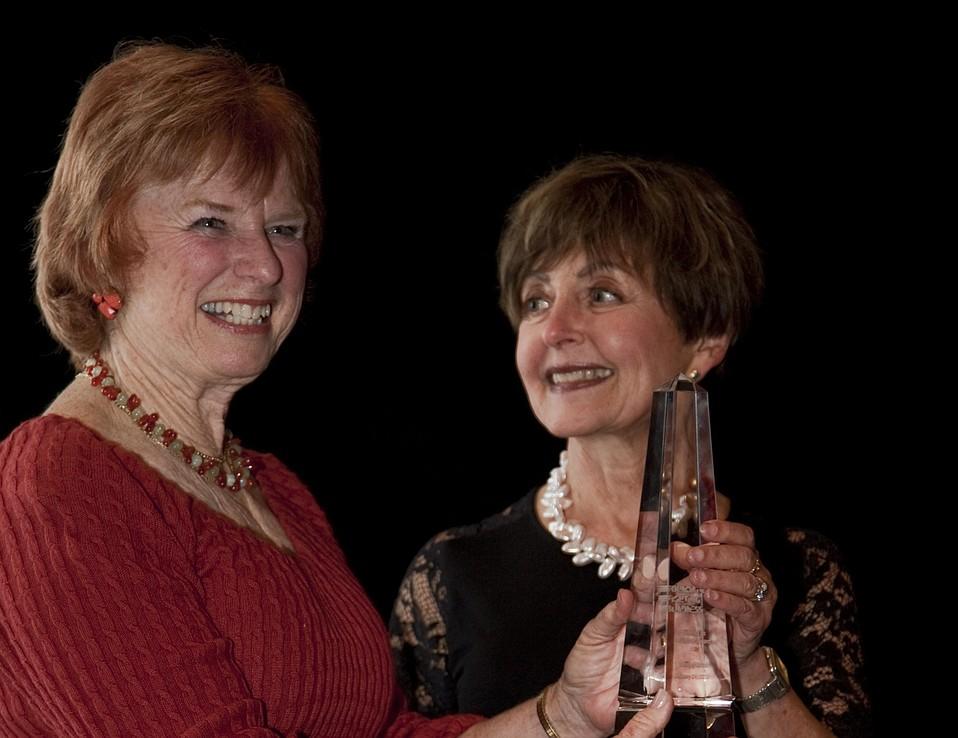 Artist Sally Hamilton (left) presents the Visionary Award to Mary Romo.