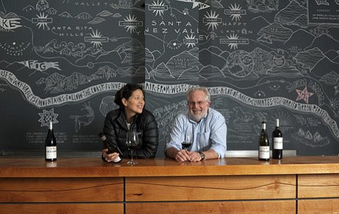 Husband Seth Kunin and wife Magan Eng sniff their new wines.