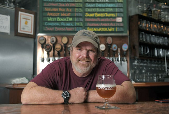 The Brewhouse's Pete Johnson, with a glass of his 1,000th batch of beer.