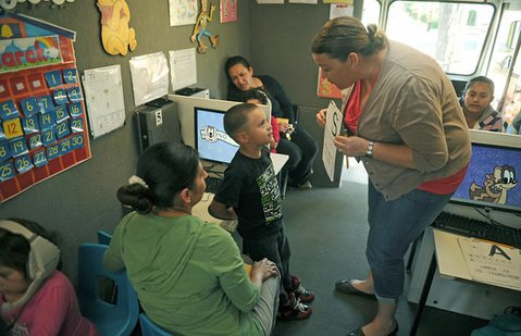 Maria Elena Millings instructs Alexander, 4, in the Mobile Waterford Lab.