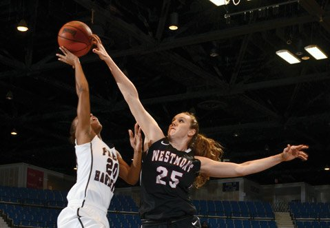 <b>DENIED:</b>  Westmont College's Kelsie Sampson (25) rejected a shot by Ashley Tate of Freed-Hardeman in the NAIA Women's Basketball National Championship Semifinals, Monday, March 18. Sampson had three blocks in the game, as Westmont upset the Lady Lions from Tennessee, 59-49.