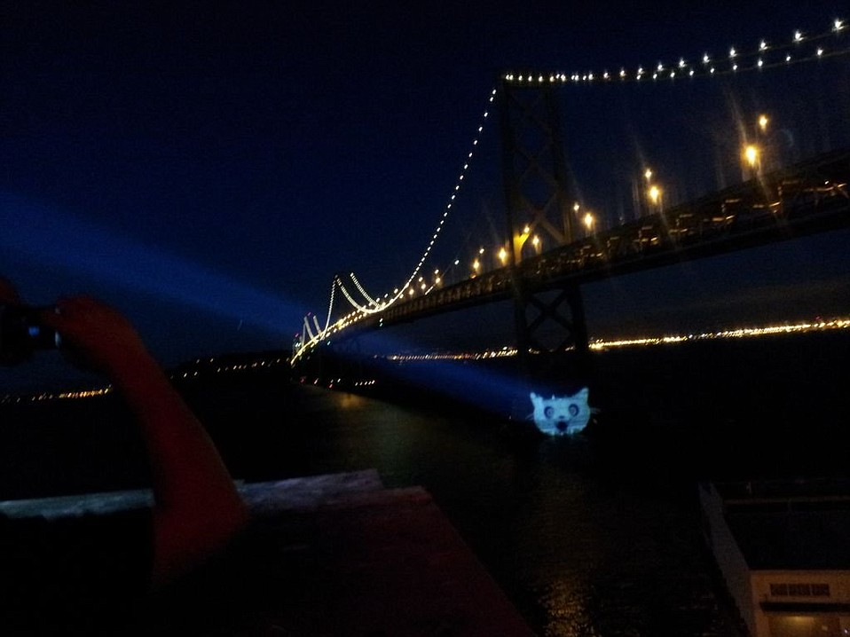 """'Cat Signal' projected on the Bay Bridge from Mozilla's headquarters. <a href=""""https://twitter.com/EFF/status/226167369486196736"""">@EFF</a>"""