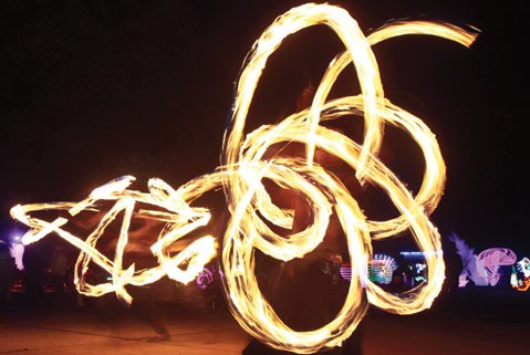 <b>LIGHT UP THE NIGHT:</b>  A fire spinner worked his magic during 2012's Lucidity Festival.