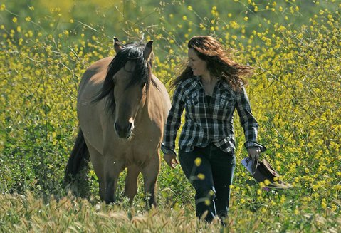 Return to Freedom founder Neda DeMayo walks beside sanctuary resident Spirit, who was the model for Disney's animated film of the same name.