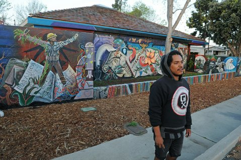 Saul Rangel was one of a few young artists who worked on the new Eastside Library mural.