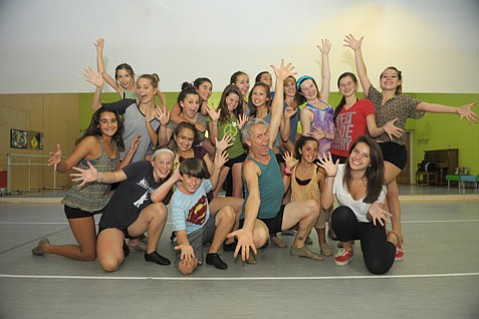 Steven Lovelace (center) is surrounded by Santa Barbara Dance Arts students.