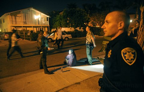 <b>BUZZKILL:</b>  Members of the I.V. Foot Patrol stopped a girl with an open container of alcohol.
