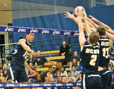 UCSB's Grant Goswiller (2) and Dylan Davis (13) put up a block against BYU star Taylor Sander during last Friday's match at the Thunderdome.