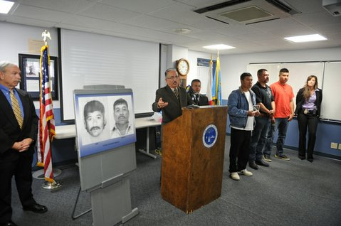 Police Chief Cam Sanchez addresses the media next to photos of murder suspect Pedro Alonso Bravo