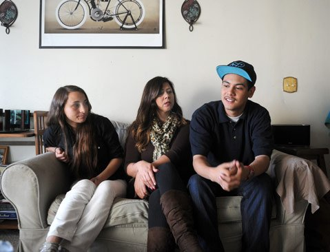 <b>RIGHT FIT:</b>  Couple Claudia Lopez and Jacob Escobar — flanking Escobar's mom, Judette Montoya — have lobbied the county office and the Santa Barbara district to save El Puente, where they have found success that was elusive at traditional schools.