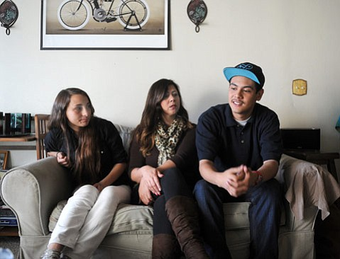 <b>RIGHT FIT:</b>  Couple Claudia Lopez and Jacob Escobar—flanking Escobar's mom, Judette Montoya—have lobbied the county office and the Santa Barbara district to save El Puente, where they have found success that was elusive at traditional schools.