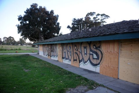 "<b>PLANNING FAST: </b> Days after being boarded up, graffiti vandals hit the Ocean Meadows clubhouse, and the new overseers are quickly determining how to best protect the property. ""There is danger of this being a little free-for-all initially,"" said UCSB's Carla D'Antonio. ""That's why the campus wants to get in there right away and let the public know what's going on."""