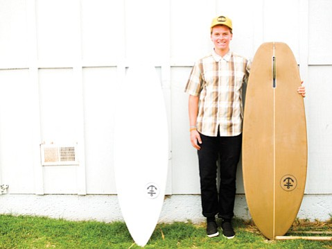 Jeff Svoboda crafts custom-made surfboards in his I.V. shop.