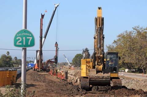 Construction crews work on the San Jose Creek channel along Highway 217.