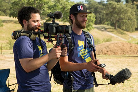 <b>FAMILY TIES:</b> Filmmakers Isaac (left) and Jacob Seigel-Boettner record on the site of <i>Singletrack High</i>.