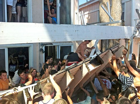 Partiers scramble to free people trapped under a collapsed balcony on Del Playa Drive.