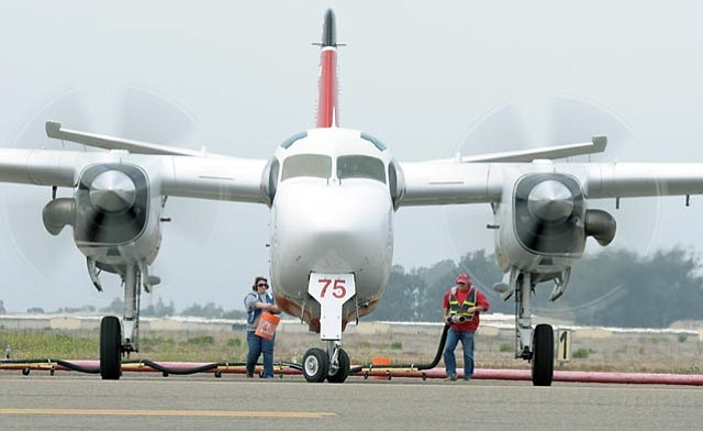 <b>BIG BIRD:</b>  Refueling crews tend to firefighting plane at the Santa Maria air tanker base on September 10, 2011.
