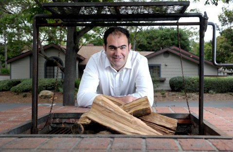 Rodrigo Gimenez like to cook with real wood.
