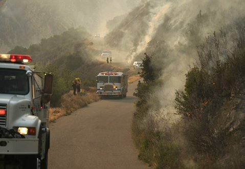 Firefighters hold the line at the fire break on Paradise Road during White Fire (May 28, 2013)