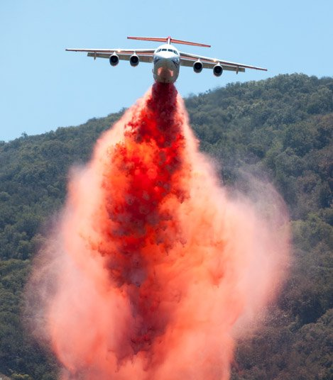 Neptune BAE 146 jet powered plane drops retardant along the north edge of the Camuesa Connector Trail as a part of containment efforts.