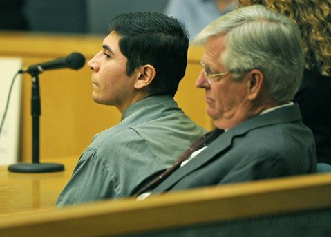 Miguel Parra sits in court with attorney Sam Eaton