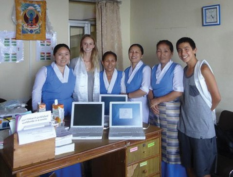 HOSPITABLE HELP: Delek Hospital (above, Delek staff and volunteers) in India is a 45-bed health- care facility for exiled Tibetans founded by the Dalai Lama. Santa Barbaran Dr. Radhule Weininger has made several trips to the facility, bringing donated items like laptops and medical equipment.
