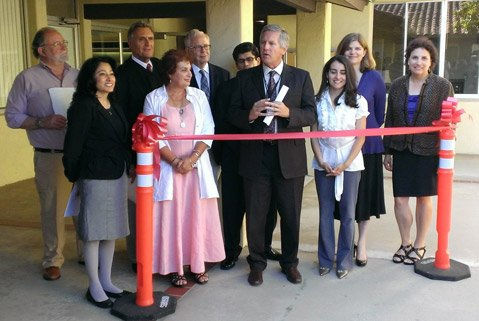 NEXT GENERATION:  Retired learning-disability advocate Les Esposito (third from left) passed the torch ​— ​in the form of a library ​— ​to Cheri Rae (in pink), who re-created it as a resource center at the Santa Barbara school district offices.