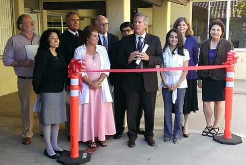 NEXT GENERATION:  Retired learning-disability advocate Les Esposito (third from left) passed the torch—in the form of a library—to Cheri Rae (in pink), who re-created it as a resource center at the Santa Barbara school district offices.