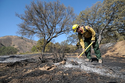 <b>FRONT LINES:</b>  A hot-shot crew mops up remnants of the September 2009 Paradise Fire.