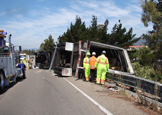 Emergency crews respond to the overturned truck on Calle Real