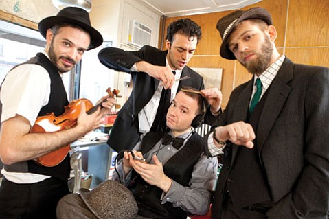 BARBERSHOP STRING QUARTET:  The members of Brooklyn Rider — (from left) Johnny Gandelsman, Colin Jacobsen, Nicholas Cords, and Eric Jacobsen—get spruced up before they travel west to the Music Academy.