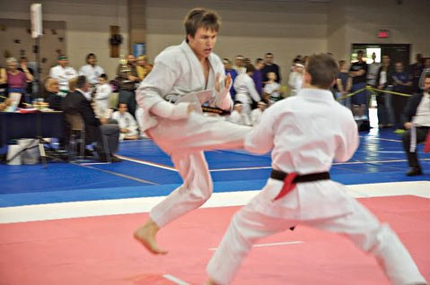 <b>KARATE CHOPPER:</b> Zachary Belway, pictured above throwing a kick in a match, earned his black belt when he was 18 years old.