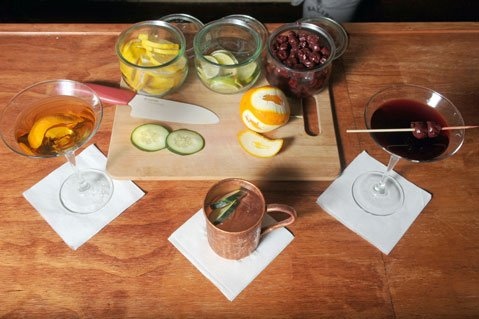 """<b>WHAT'S YOUR POISON?</b> The Bourbon Room's whiskey cocktail, Moscow Mule, and """"Chelsea"""" — a twist on a Manhattan — are worth the trip."""