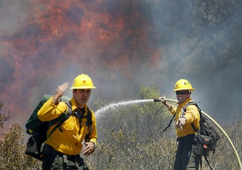 US Forest Service firefighters signal for more water as they battle the Rice Fire (June 20, 2013)