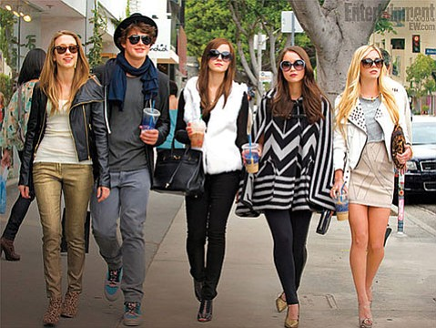 <b>ALL THAT GLITTERS:</b>  Emma Watson (center) and a cast of fresh-faced unknowns play a real-life outfit of celebrity-robbing teens in Sofia Coppola's <i>The Bling Ring</i>.