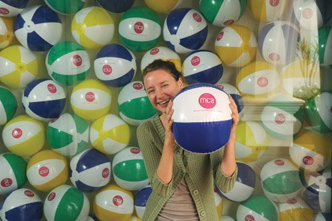<b>A NEW BALLGAME:</b>  Nicole Biergiel, MCA Santa Barbara assistant director, holds a beach ball bearing the museum's new logo.
