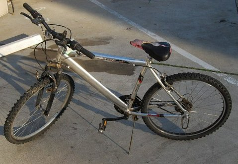 "The owner of this bike ""is considered a person of interest"" in the murder investigation, police said"